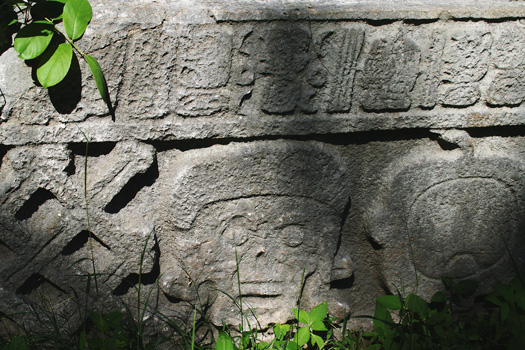 Carved hieroglyphs of a human skull at Grupo del Cementario